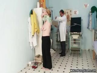 mature housewife taking her garments part2