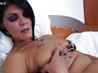 mature slut mommy masturbating on her bed