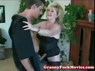mad golden-haired granny with younger guy