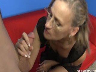 mature woman jerks a lustful youthful boy