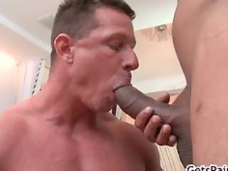 mature muscle guy engulfing black schlong part0