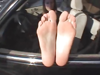 older lady shows soles n feet