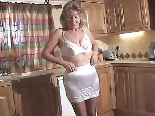 captivating granny in dark hose toying on the