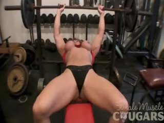 mature pumped up woman plays with large love