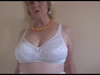 aged breasty lady in nylons and sheer slip