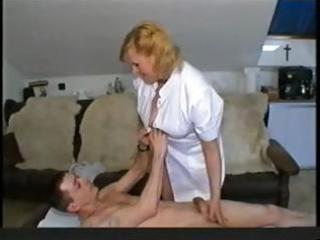 Chubby blonde granny nurse gives her patient head