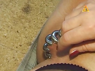 enormous pierced slave with lots of rings in her