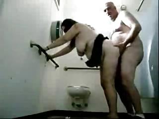 stud copulates a granny in public toilets