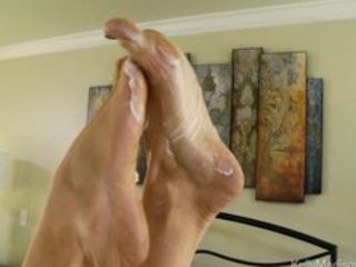 super titted wife gives a awesome footjob