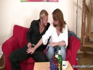 beautiful red-haired milf with big breasts sucks