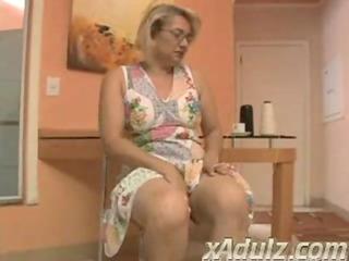 chunky golden-haired granny doing crochet gets