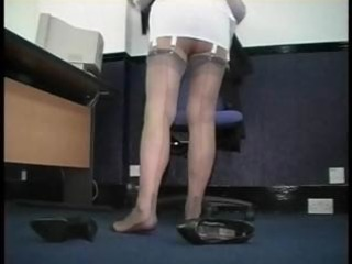 mature secretary teases in corsets and nylons