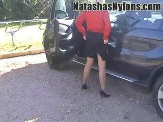 wench wife teases out dogging in seamed silk