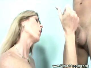 dirty blond milf has her hands ful
