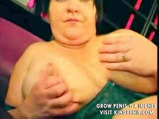 large bulky busty lady uses a dildo in advance of