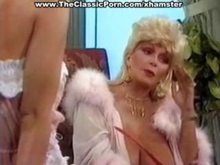 busty mature classic golden-haired star gives a