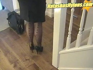 business boss with large zeppelins in dark nylons